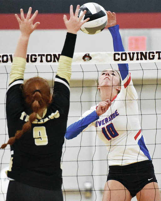 Riverside's Lauryn Sanford spikes against Botkins' Meg Russell during a Division IV sectional final on Oct. 24 at Covington High School. Sanford was named the Northwest Central Conference's player of the year.