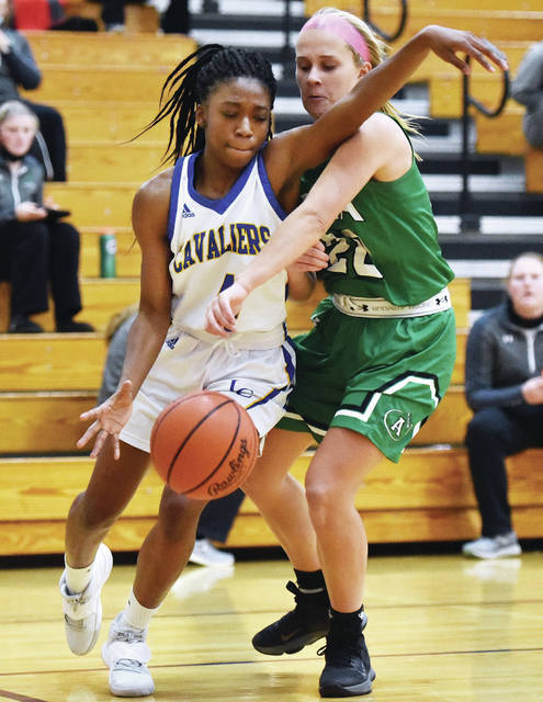 Lehman Catholic's Kiersten Franklin tries to dribble by Anna's Ella Doseck during a nonconference game on Saturday in Sidney. Doseck, who was a first team all-Shelby County Athletic League selection last season, scored 17 points against the Cavaliers.