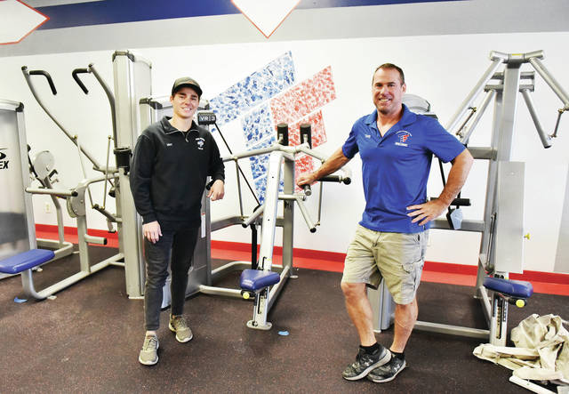 Max Chappie, left, stands with his dad, Tony Chappie, both of Piqua, on Saturday, Oct. 31, in what will soon be Tony Chappie's new Total Fitness gym at 1524 Michigan St. in the Sidney Plaza.
