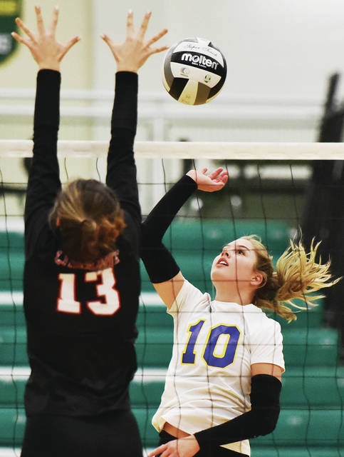 Russia's Ashley Scott spikes as Fort Loramie's Maya Maurer tries to block during a Division IV regional semifinal on Thursday at Northmont High School's Thunderdome in Clayton.