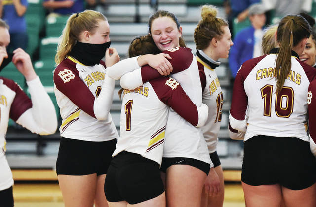 New Bremen's Katie Howell, left, and Claire Pape hug after a Division IV regional final on Saturday at Northmont High School's Thunderdome. The Cardinals won 3-1 to earn their fourth consecutive state berth.