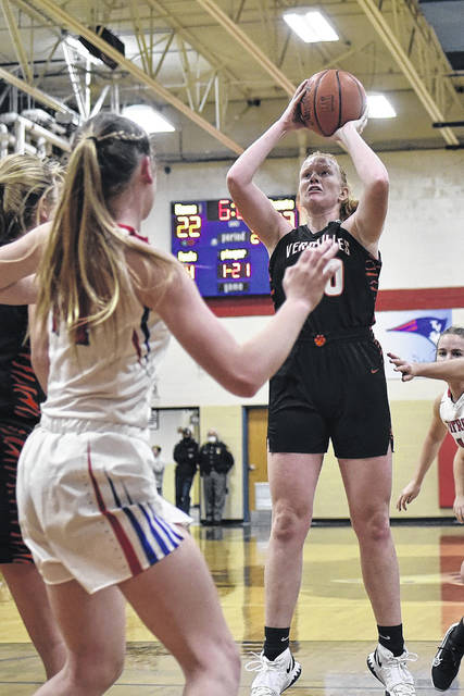 Versailles junior Hannah Dirksen shoots during a nonconference game against Tri-Village on Friday in New Madison. Dirksen led the Tigers with 10 points in the 80-42 loss.