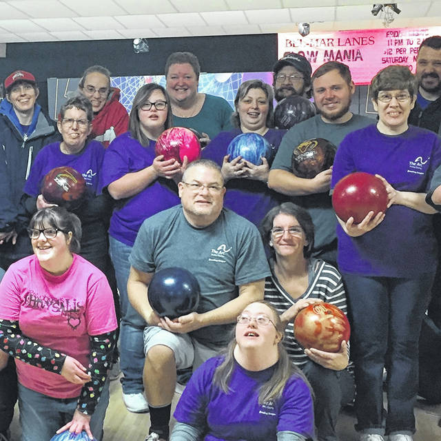 Members of Shelby County Arc's 2020 Bowling League pose with Tony Sell, center, and his wife, Tracy, of Sidney, after an afternoon of bowling earlier this year. Sell has coordinated this lively league, which averages 40 participants of all ages, for the past 10 years.