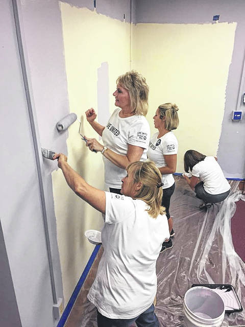 Members of the Shelby County United Way's POWER women's initiative volunteer painting at the CASA office during the Day of Action. Match Day gifts will support grants awarded by POWER to local organizations.