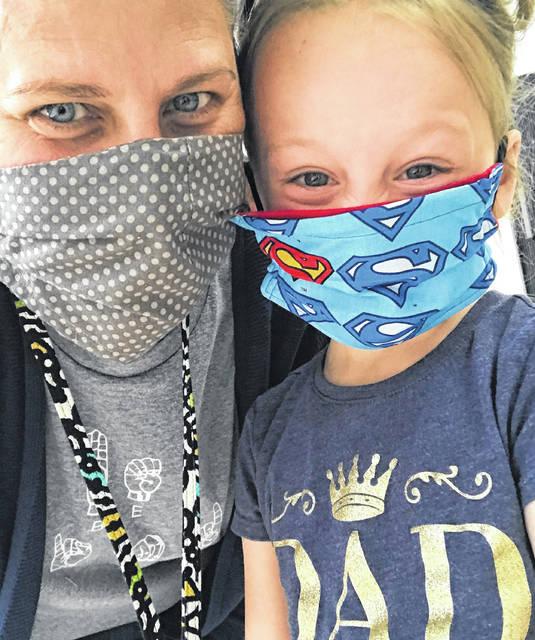 Wilma Valentine Childcare employee Kim Cummins and student Khloe show off their super masks. The childcare center will use Match Day gifts to support operating expenses impacted by the pandemic.