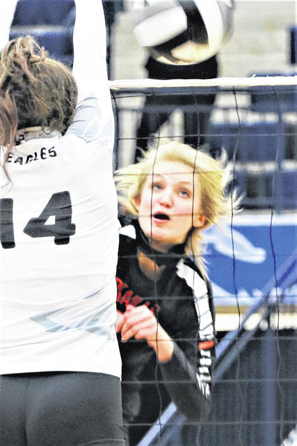 Natalie Dirksen comes down after making a spike during a Division III regional final against Cincinnati Hills Christian Academy on Saturday at Trent Arena in Kettering.