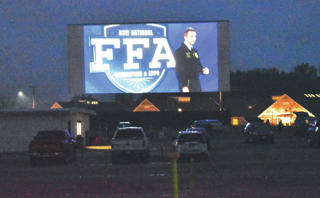 People watch the 93rd National FFA Convention and Expo at the Sidney Auto Vue Drive-in Theatre on Tuesday, Oct. 27.