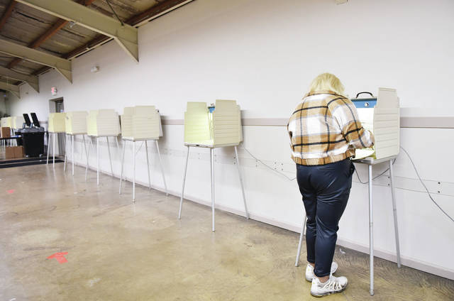 Amrielle McGhee, of Sidney, prepares to fill out a ballot in the polling station located at the Shelby County Fairgrounds on Tuesday, Nov. 3. At 11:30 p.m. traffic was steady but there were no lines.