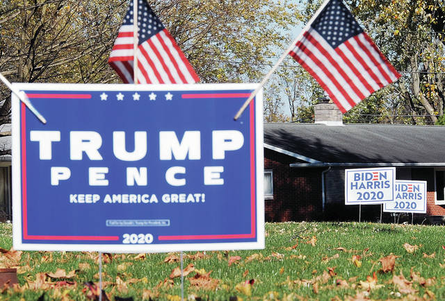 Trump and Biden signs adorn the yards of two neighbors along Port Jefferson Road on the day after the presidential election, Wednesday, Nov. 4. Trump again won Shelby County. Nationally the race has been much closer.