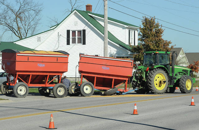 The front axle of a grain wagon loaded with freshly harvested corn broke while being pulled by a tractor out of the parking lot of the Community Veterinary Clinic at 1200 W. Russell Road shortly before 3 p.m. on Wednesday, Nov. 4. The tractor was using the parking lot to leave an adjacent corn field. Cones were set up to redirect west bound Russell Road traffic around the tractor. A small amount of corn was spilled.