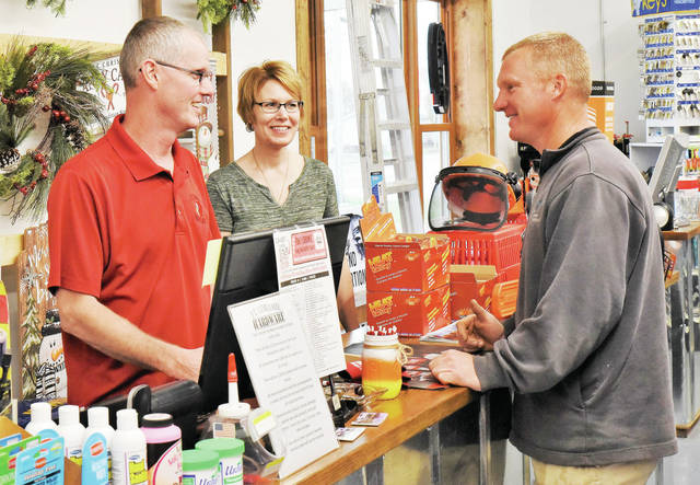 Steve, left to right, and Linda Berger, of Yorkshire, celebrate the Grand Opening of Ft. Loramie Hardware Store by helping customer Nick Eilerman, of Fort Loramie, on Thursday, Nov. 5. The hardware store is located at 101 S Main St, Fort Loramie.