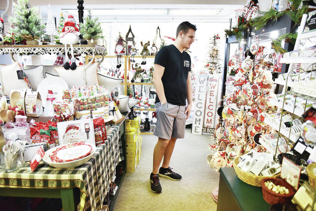 Blake Alan Steenrod, of Sidney, peruses the Christmas items for sale at The Ivy Garland's Christmas Open House on Friday, Nov. 6.
