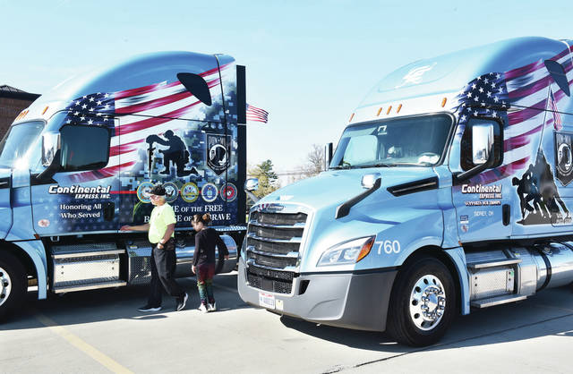 Rick Brown, left, and his granddaughter, Carly Nelson, 9, both of Sidney, daughter of Derickia Nelson, look at the new veteran themed semi cab that Continental Express Inc. is letting him drive. Brown was presented with the semi cab on Friday, Nov. 6. Brown is a United States Air Force veteran.