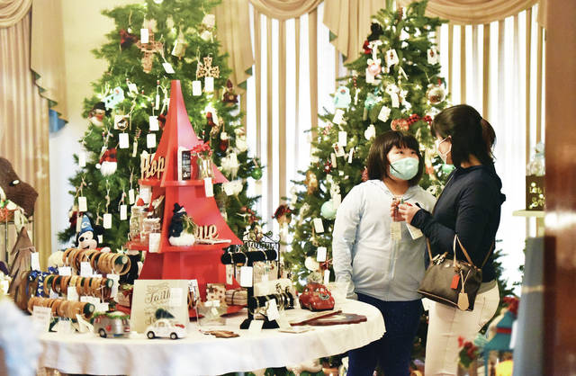Yuri Fujisawa, right, shops with her daughter Misaki Fujisawa, 10, both of Sidney, at the Angels in the Attic Craft Show on Wednesday, Nov. 11. The show continues at the Ross Historical Center on Nov. 13 from 10 a.m. - 8 p.m. and Nov. 14 from 9 a.m. - 5 p.m..