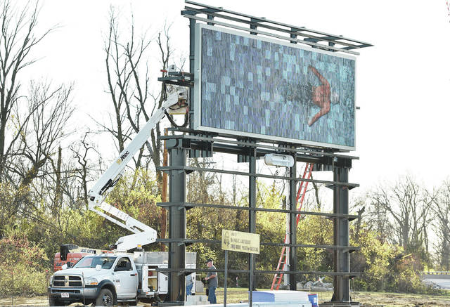 The new privately owned electronic billboard located at the intersection of Michigan Street and 4th Avenue is switched is turned on for the first time on Tuesday, Nov. 10.