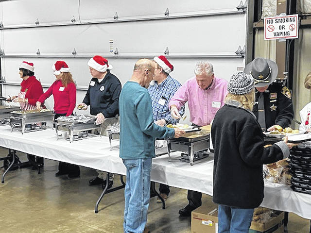 Volunteers prepare fill the plates for a previous Community Christmas Dinner. Because of COVID-19, the meal will be a drive-thru event only on Dec. 5.