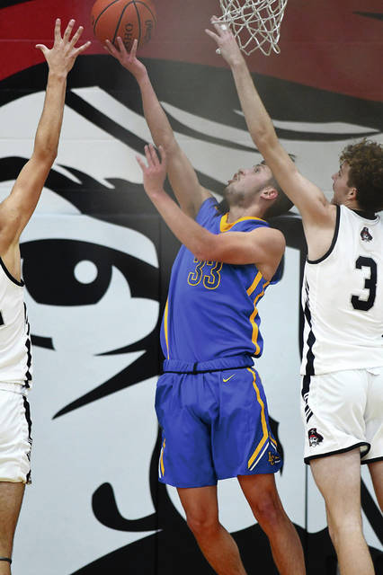 Lehman Catholic's Luke Frantz shoots during a nonconference game on Saturday at Covington High School.