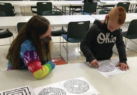Hailey Sebring, left, daughter of Sheila Sebring, works on a craft with Tanner Pilkins, son of Christina Dinkins.
