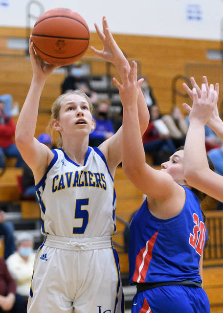 Lehman Catholic freshman forward Mara O'Leary shoots with pressure from Riverside's Jade Copas during the first half of a Northwest Central Conference game on Thursday at Schlater Family Gymnasium in Sidney. O'Leary led the Cavaliers with 14 points and 11 rebounds in the 42-36 win.