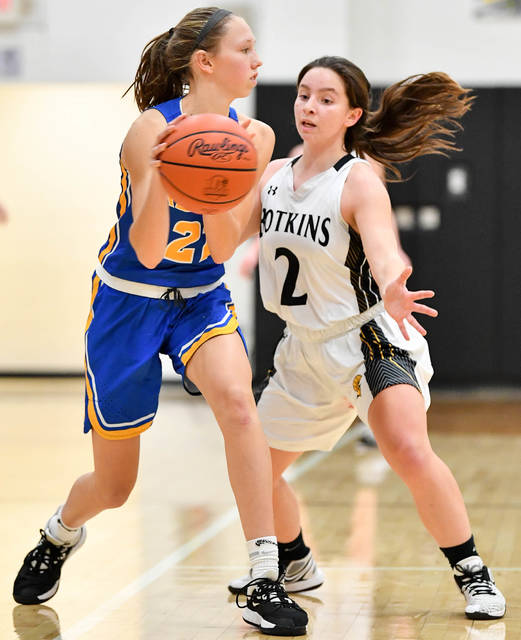 Russia junior guard Sophie Francis looks to pass with pressure from Botkins' Camdyn Paul during a Shelby County Athletic League game on Monday in Botkins. The Raiders' struggled early against Botkins' pressure and scored four points in the first quarter.