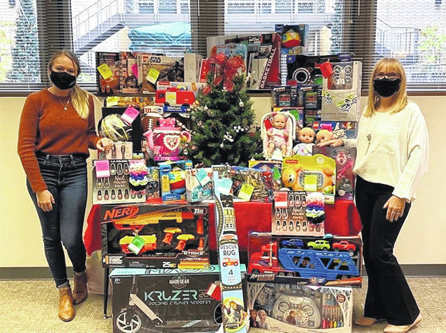 Celina Insurance Group employees Elena Knapke and Amy Nelson prepare to deliver gifts for the Mercer County Angel Tree Program.