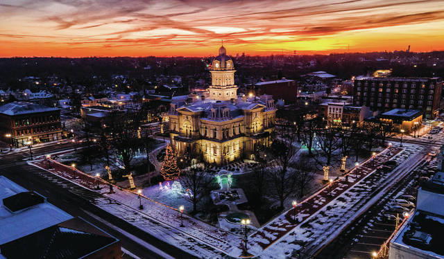 As the year 2020 finally comes to a close, the view from the northeast corner of the courthouse square reflects the sun setting on Saturday, Dec. 26. From the Sidney Daily News family, we wish all our readers a Happy New Year.