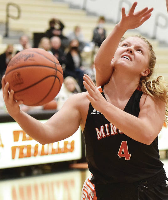 Minster senior guard Ivy Wolf shoots during a Midwest Athletic Conference game on Thursday in Versailles. Wolf led the Wildcats with 30 points in the 63-27 victory, which was their season opener.