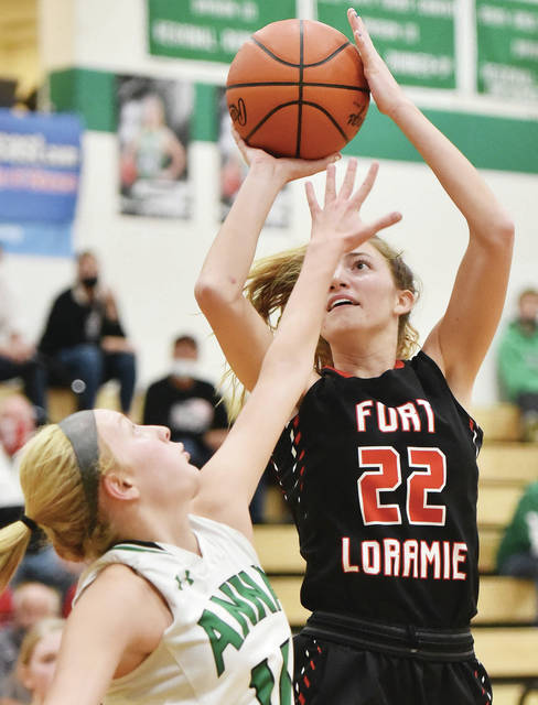 Fort Loramie's Kenzie Hoelscher shoots over Anna's Breann Reaman during a Shelby County Athletic League game on Saturday in Anna. Hoelscher scored nine points and had five rebounds.