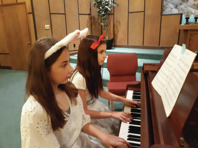 Amelie Phillips, left, and Alice Chrisman perform in the Midwest Duettist Competition. Both girls are 12 years old and in the sixth grade at Fairlawn Local Schools.