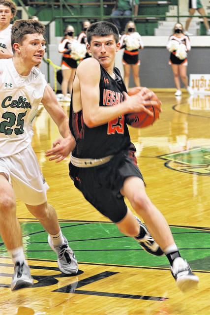 Versailles' Jayden Litten drives the lane during a nonconference game on Saturday in Celina. Litten scored nine points.