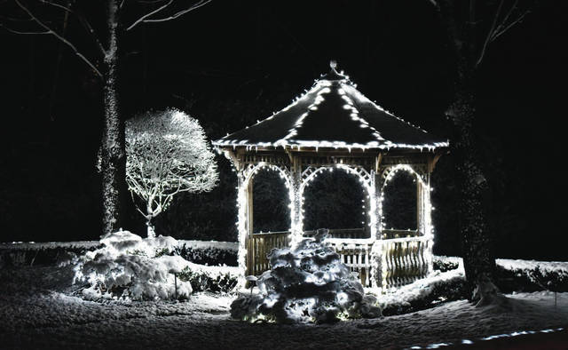The first substantial snow of the season covers the garden located at the intersection of Broadway Avenue and E Lyndhurst Street on Monday, Nov. 30. Santa normally stops by the garden each year but will not make an appearance this year due to COVID-19.