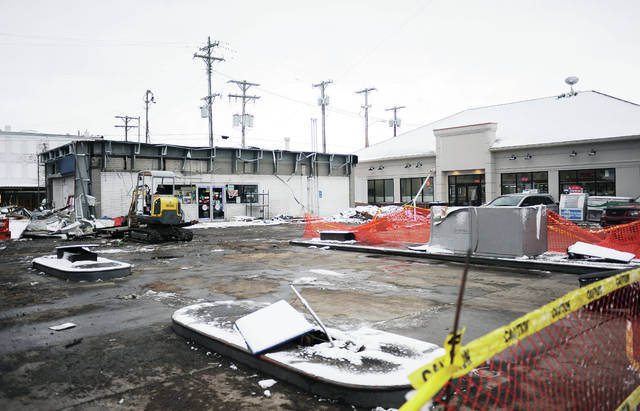 The old Clark gas station, located at 124 Court Street, will be torn down in a few days to make room for a larger parking lot and more gas pumps that will be used by the new store on the right.