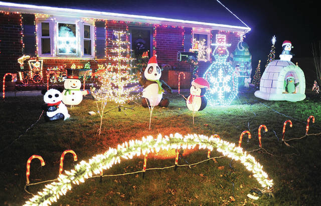 Christmas lights flash in sync with music at a house on 6th Street on Tuesday, Dec. 8.