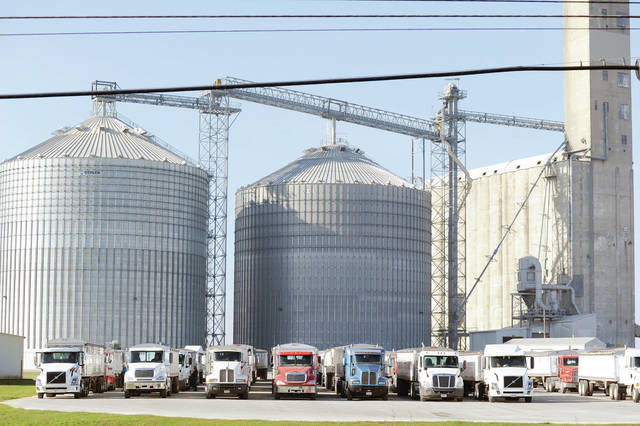 Semi tractor trailers loaded with grain wait on Wednesday, Dec. 9 in a packed parking lot in front of the the old grain elevator currently owned by Cargill and located near the intersection of Campbell Road and S Vandemark Road.