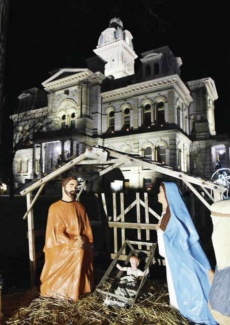The manger scene on the courtsquare is lit up as the Shelby County Courthouse looms up from behind on Tuesday, Dec. 15.