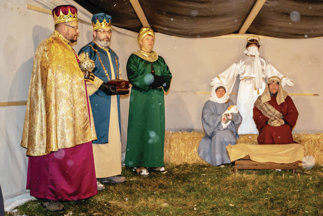 A live nativity is held at Faith Alliance Church in New Bremen on Wednesday, Dec. 16. The nativity included real animals such as camels.