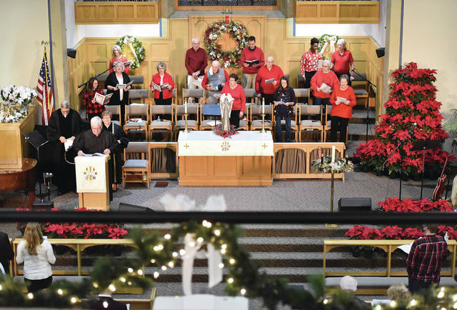 A socially distanced choir sings during the traditional Christmas Eve service held at 11 p.m. by the Sidney First United Methodist Church.