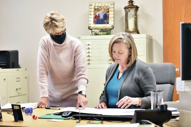 Dianna Reisinger, left, looks over a map with Angela Hamberg, on Thursday in an office at the Shelby County Annex Building. Hamberg is replacing Reisinger, who has retired as the executive director of the Shelby County Regional Planning Commission.