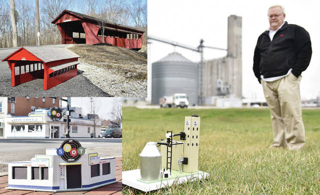Lawrence Thayer, of Sidney, looks down at a model he made of The old grain elevator currently owned by Cargill and located near the intersection of Campbell Road and S Vandemark Road, on Monday, Dec. 29. In 2015 Thayer had some extra time on his hands and decided to make models of Sidney landmarks which included the Ross covered bridge at Tawawa Park, the Big Four Bridge, The Spot and Bonnyconnellan Castle. Thayer used to use them as part of a model railroad setup he used to have but now hopes to find a safe place for the models someday where they can be enjoyed.