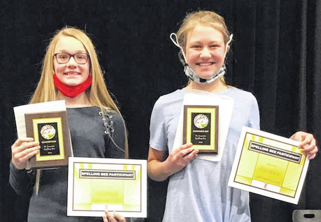 Fort Loramie Spelling Bee Champion Avery Bergman, left, and runner-up Hailey Meyer represented their grades in the school's friendly competition.