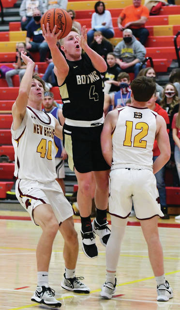 Botkins' Zane Paul shoots with pressure from New Bremen's Nathan Rindler, left, and Nick Alig during a nonconference game on Saturday in New Bremen.