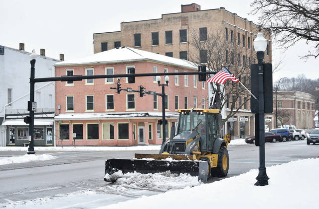A backhoe clears snow from Ohio Avenue on Sunday, Jan. 31.