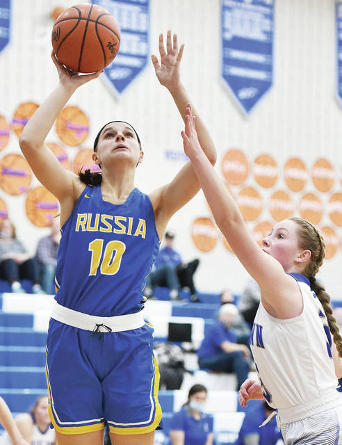Russia junior forward Ella Hoehne shoots with pressure from Fairlawn's Lonna Heath during a Shelby County Athletic League game on Thursday in Sidney. Hoehne led the Raiders with 20 points while Heath scored 10 for the Jets.