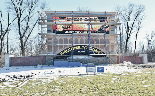 """The new electronic billboard and """"Welcome to Sidney Home of Wilson Health"""" sign located at the intersection of Michigan Street and 4th Avenue is almost finished. The sign is built on Wilson Health property and the sign is owned by Kenjoh Outdoor Advertising. Letters were placed on the sign by NCI Signs, LLC. A depiction of the Big Four Bridge can be seen between the electronic billboard and the """"welcome"""" sign. Plants will later be placed around the sign. A final piece of the sign still needs to be attached to the very top of the billboard as well."""