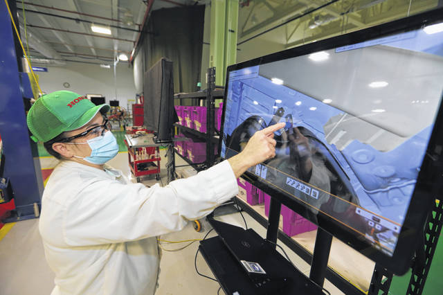 An associate perfects her assembly techniques for 2022 Acura MDX using the new virtual training software at the East Liberty Auto Plant.