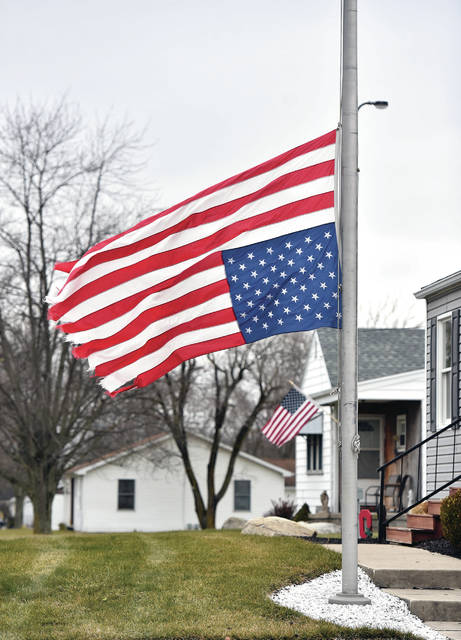 """A large U.S. flag flies upside-down and at half-mast on the 10000 block of State Route 47 on Friday, Jan. 8. The flags owner, Dave Nagel, of Sidney, flipped his flag and lowered it in response to the storming of the U.S. Capitol building. Nagel said """"My feeling on it is our country is in distress. If the Democrats can illegally overrun our election what will they do when they have full power behind closed doors. God please help our country."""""""