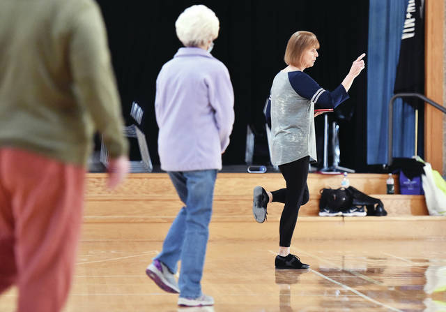 Paula Coder, far right, of Houston, teaches a line dancing class at the Senior Center of Sidney-Shelby County on Thursday, Jan. 14.