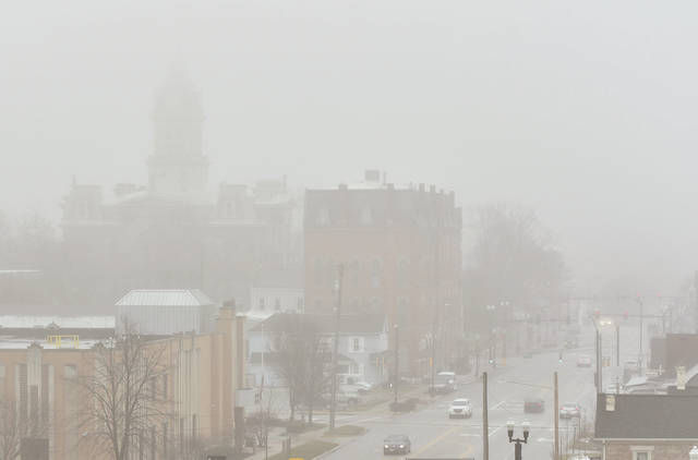 Fog shrouds downtown Sidney at 10:00 a.m. on Tuesday, Jan. 26. While misting rain didn't create the heavily ice covered roads many feared it did contribute to a heavy morning fog.