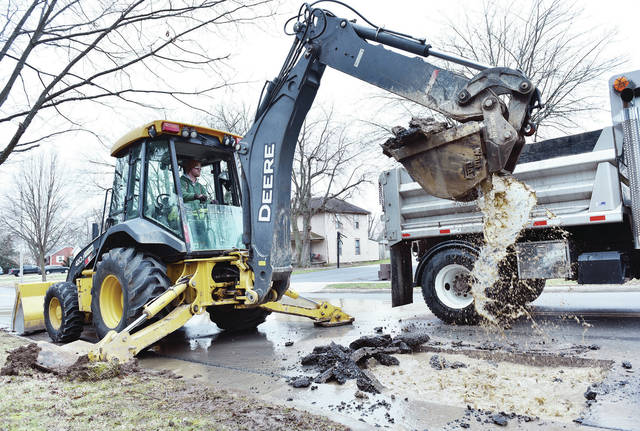 City of Sidney employee Zach Clark, of Anna, excavates a hole to expose part of a 6 inch cast iron water pipe that broke on Wilson Avenue near Park Street. The pipe broke on Wednesday, Jan. 27 and was expected to only take a few hours to fix.