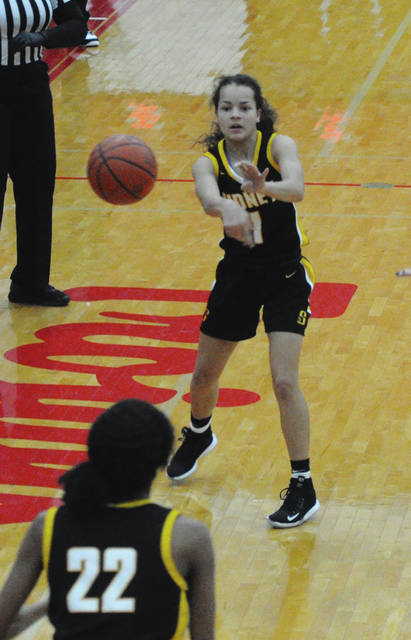 Sidney freshman guard Kiara Hudgins passes to Samantha Reynolds during a Miami Valley League game on Friday at the Trojan Activities Center in Troy.